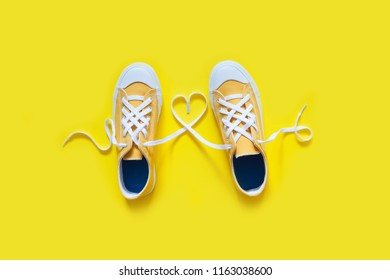 Short low  bright sneakers on a yellow background.