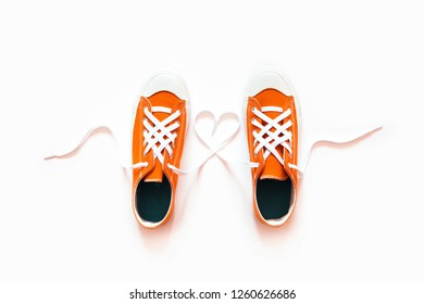 Short low  red bright sneakers on a white background.