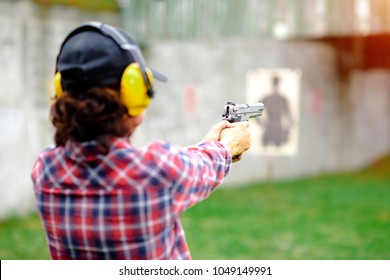 Short magazine gun in hand of old woman being for practice on arm and weapon martial art for woman
