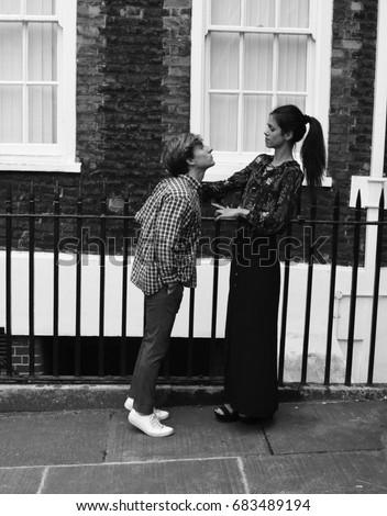 Tall woman kiss