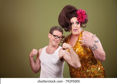 Short muscular man with impressed heavy-set drag queen