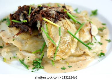 Short Rib Pierogies - Pierogies filled with slow braised short ribs and mushroom sauce