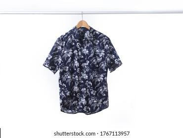 Short sleeved floral leaves,plant, pattern shirt closeup on hanger