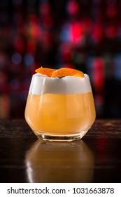 short sour cocktail on the dark bar