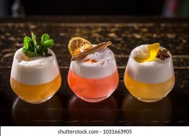 short sour cocktails on the dark bar