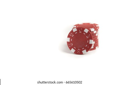 A short stack of red gaming chips isolated against a white background.