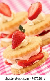 Shortbread biscuits/cookies with a strawberry and cream filling.