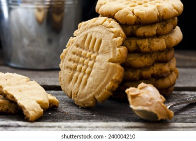 shortbread cookie with peanut butter on a black background