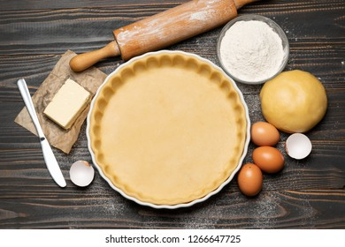 shortbread dough for baking quiche tart and ingredients in baking form