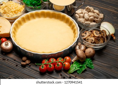 shortbread dough for baking quiche tart in baking form and ingredients