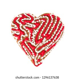 Shortbread dough cookies in the shape of a heart, decorated with icing. Isolated on white background. Attribute of Valentine's Day