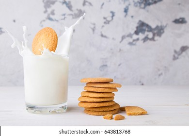 Shortbread kamut cookie falling into a glass of milk