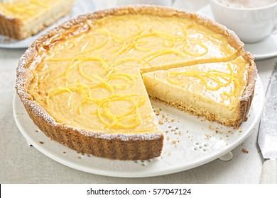 Shortcrust pastry lemon tart topped with lemon rind