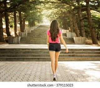 shorts girl on the stairs in the sun