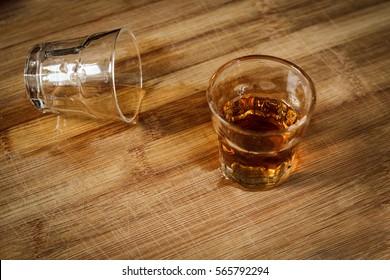 Shorts of Whiskey splatter on the counter