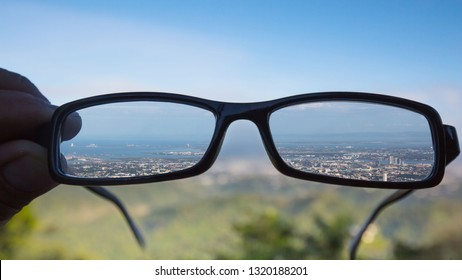 shortsighted eye glasses sharp panorama view over Cebu City with out of focus photo parts