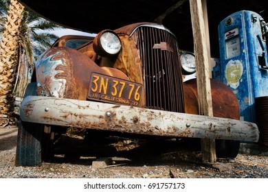 SHOSHONE, USA - JANUARY 2, 2017: Abandoned petrol station with rusted car in Shoshone, California