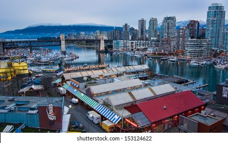 Shot from above Granville Island Market and Vancouver skyline