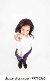 shot from above of a young woman pointing at camera