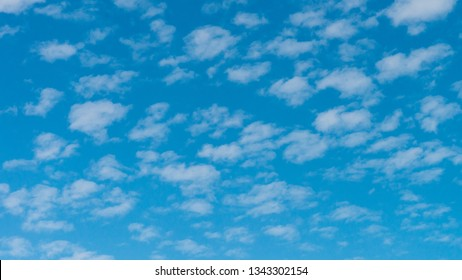A shot of an abstract formation of clouds in a blue sky.