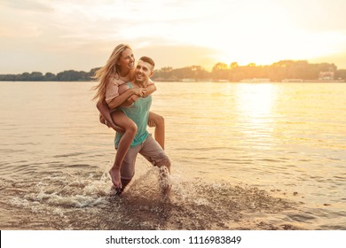 Shot of an affectionate young couple having fun on the beach.