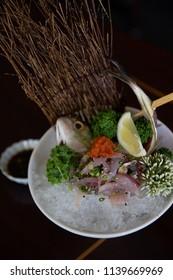 Shot of Aji Tataki sliced and Served with Ponzu sauce