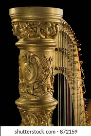 Shot of ancient harp of last century  beginning on the black background. Detail.