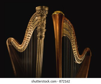 Shot of ancient harp of last century  beginning on the black background.