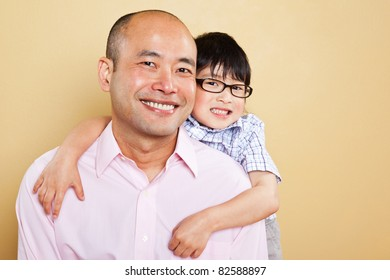 A shot of an Asian father and his cute son