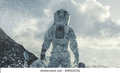 Shot of the Astronaut Walking Through Blizzard on Frozen Alien Planet Towards His Base/ Research Station. Technological Advance Brings Space Exploration, Colonization.