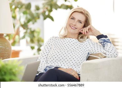 Shot of a attractive senior woman relaxing at home while looking at camera and smiling.