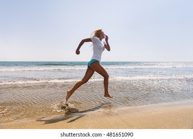 Shot of an attractive young woman running on the beach. Having a fun time at the beach