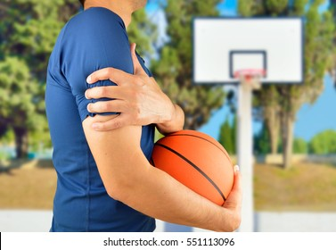 Shot of a basketball player with a shoulder injury at oudoors