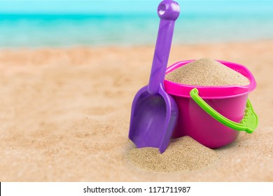 Shot of the beach on a sunny day, with a spade and bucket