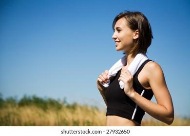 A shot of a beautiful caucasian girl exercising outdoor