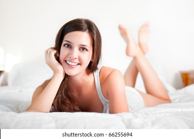 A shot of a beautiful girl lying down on the bed