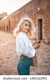 Shot of beautiful happy blonde hair woman. Fashion woman posing. Film grain look