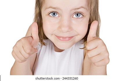 Shot of a Beautiful Little Blue Eyed Girl with her Thumbs Up against White Background