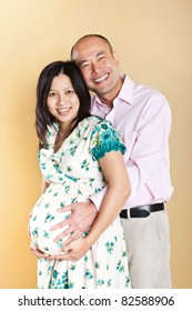A shot of a beautiful pregnant Asian woman with her husband
