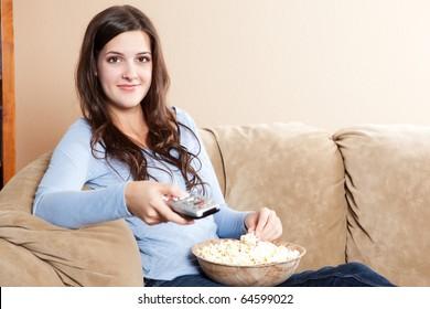 A shot of a beautiful woman watching television