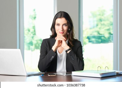 Shot of a beautiful young businesswoman looking thoughtful while sitting at office desk.