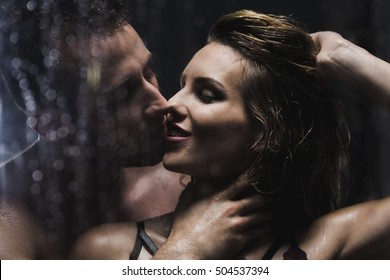 Shot of a beautiful young couple kissing in the shower