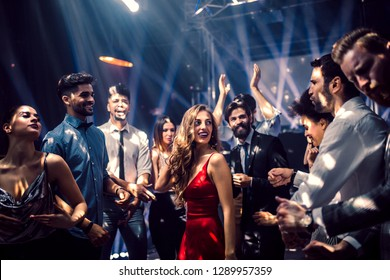 Shot of a beautiful young woman dancing with friends