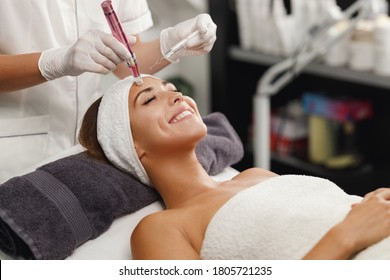 Shot of a beautiful young woman on a facial dermapen micro-needling treatment at the beauty salon.