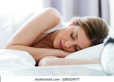 Shot of beautiful young woman sleeping in the bedroom.