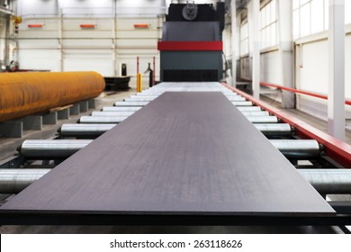 Shot blasting machine for processing of metal plates and profiles. Focus on the edge of plate