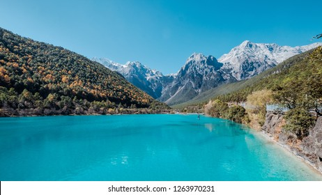 Shot of the Blue Moon Valley in Lijiang, Yunnan - China, with the famous Jade Dragon Mountain in the background. The place is famous for its turquoise blue water.