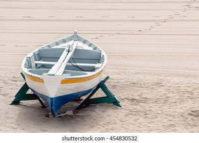 A shot of a boat in the sand