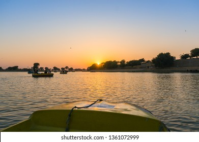 Shot from boat of sunset at gadi sagar lake jaisalmer. This man made reservoir is a famous tourist destination for boating, boat rides and watching the sunset