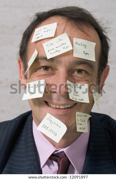 A shot of a business man's head covered in yellow sticky-notes.